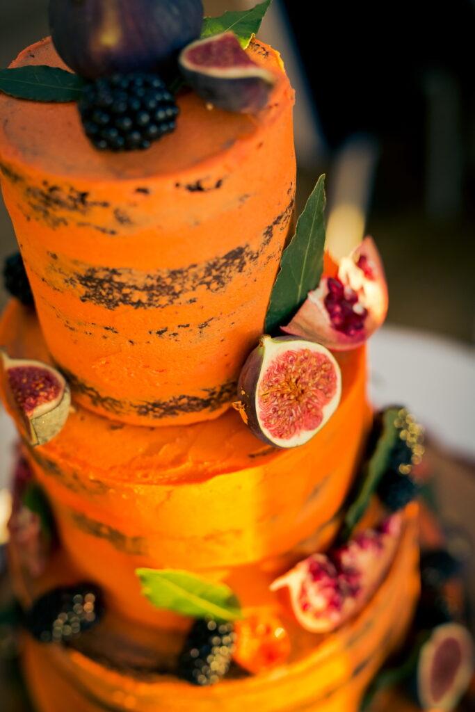 Orange, halloween style wedding cake with figs