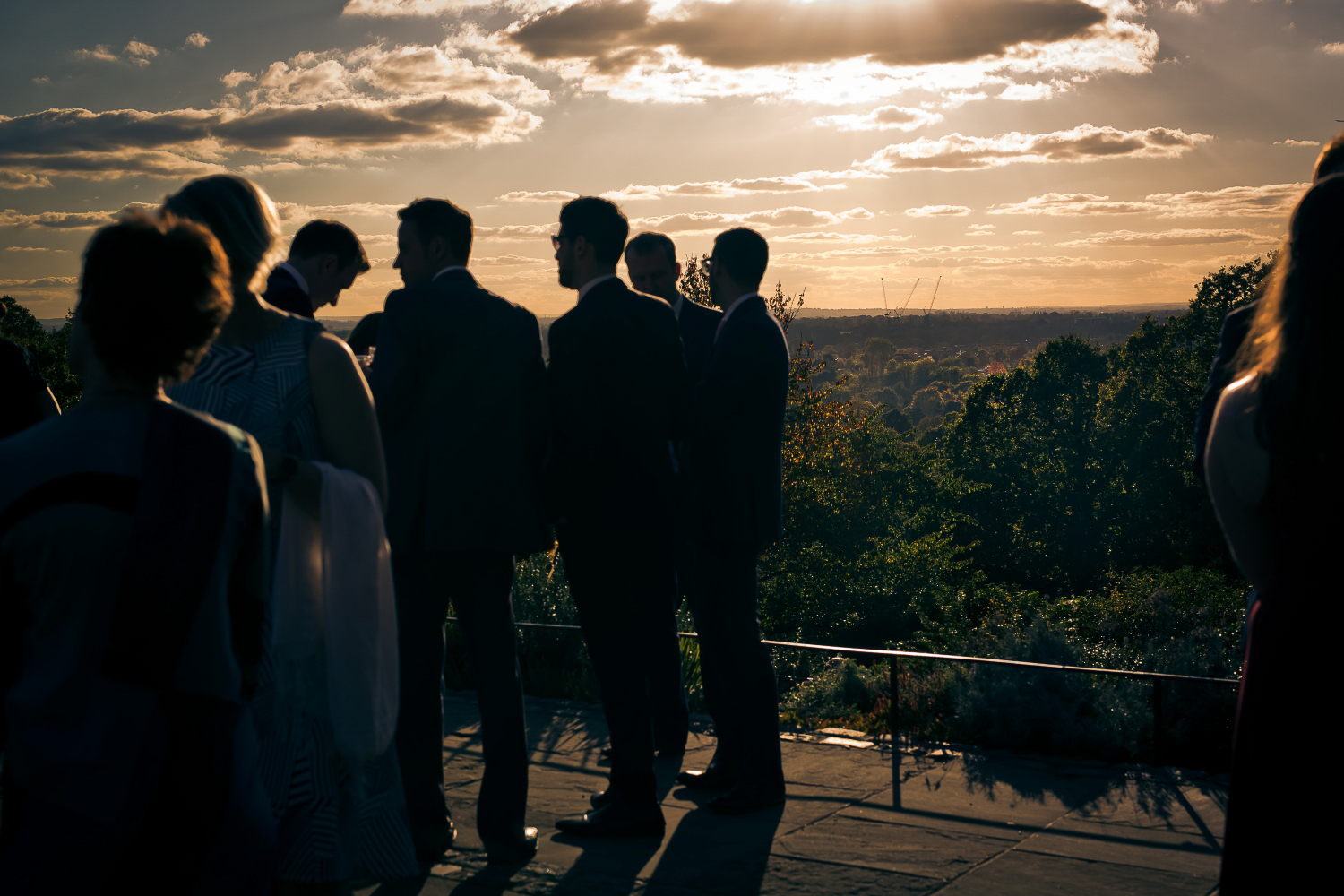Mingling at a wedding as the sun begins to go down