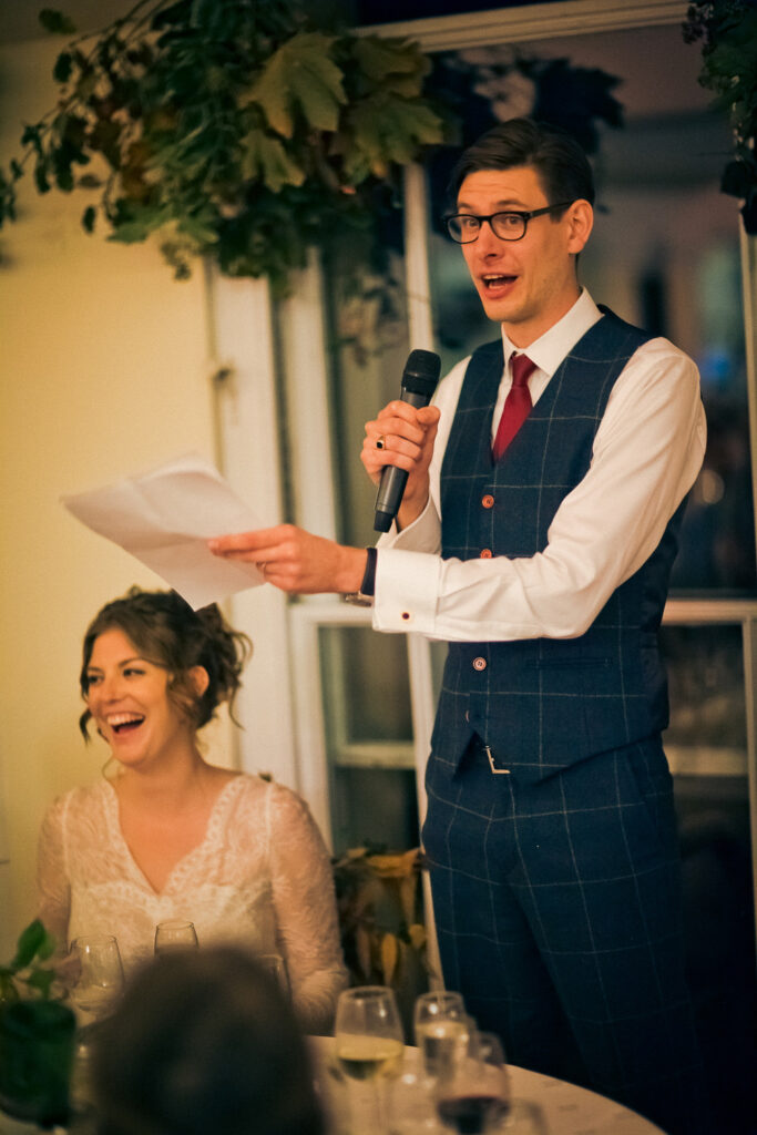 The groom's speech, making the bride laugh